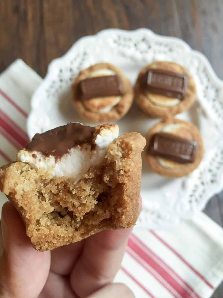 Campfire s'mores cups are the perfect summertime treat. A crunchy graham cracker cup is filled with a perfectly toasty marshmallow and topped with a melty piece of chocolate. This one is so simple to make, it'll be on repeat all summer long!