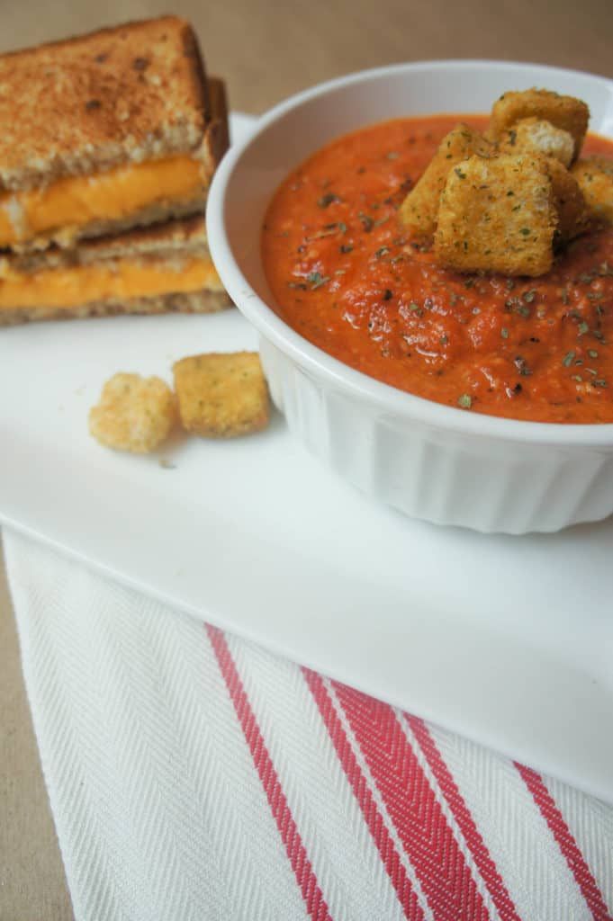 Creamy Tomato soup is the perfect fall food that will last throughout the winter months. Served with a grilled cheese sandwich, this is the ultimate comfort food!