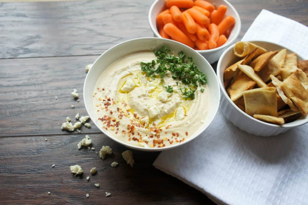 This classic roasted garlic hummus is the perfect Mediterranean appetizer or afternoon snack to enjoy with veggies like carrots and celery or with pita chips. The perfect healthy after school snack for kids!