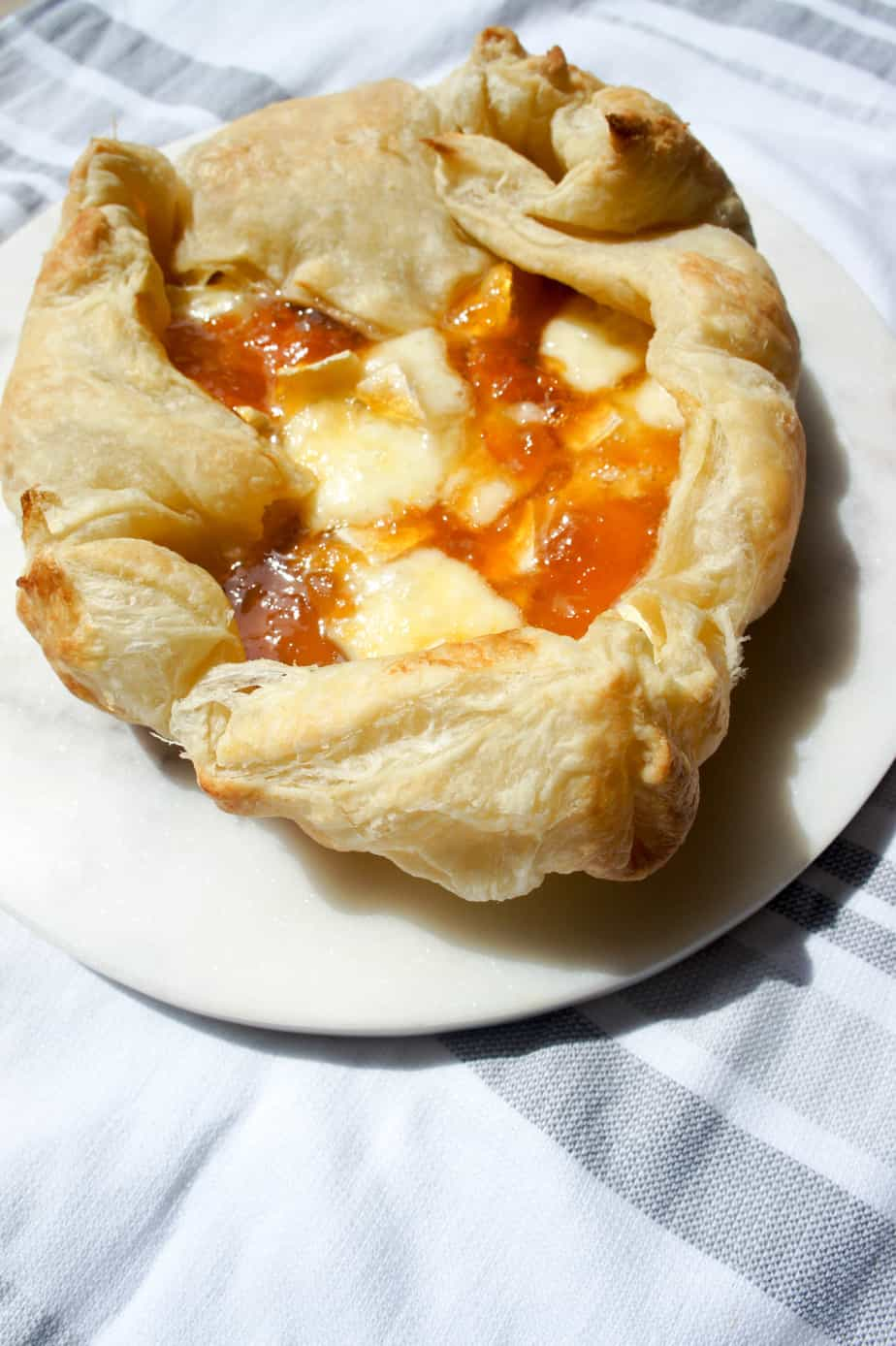 Baked Brie and Apricot Jam can easily be made in a puff pastry for a crowd, or a small ramekin for a few. Easy, delicious game food.
