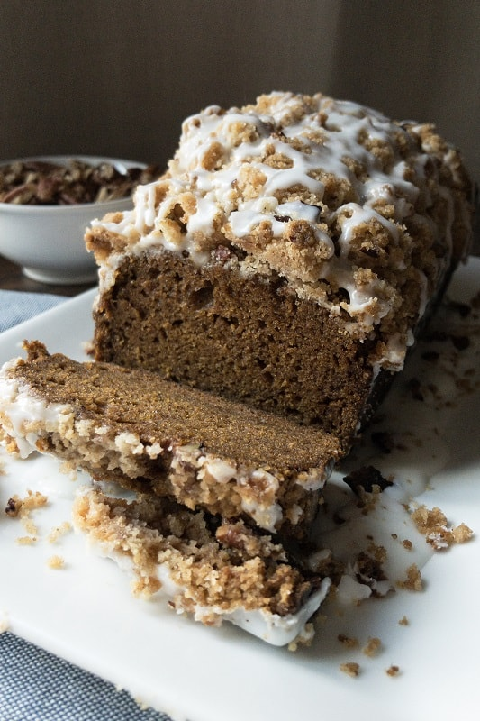 Glazed Pumpkin Pecan Streusel Loaf. A perfect cross between a cake and bread, with all the Fall flavor and a heavy drizzle of glazed, nutty goodness! #pumpkinspice #fall