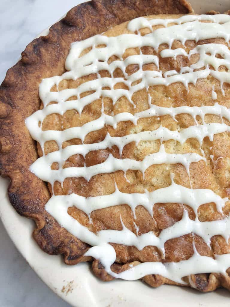 Snickerdoodle Pie is just like a jumbo Snickerdoodle cookie. Cinnamon sugar goodness inside a buttery crust topped with a delicious glaze!