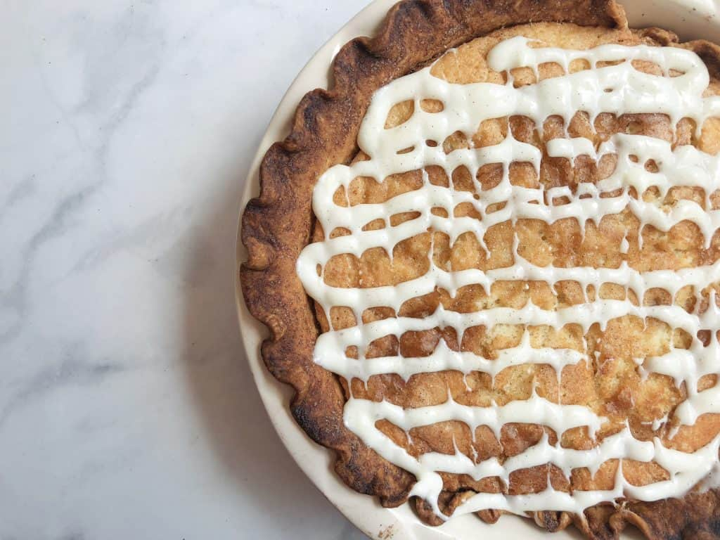 Cinnamon Sugar Snickerdoodle Pie is just like a jumbo Snickerdoodle cookie.  Cinnamon sugar goodness inside a buttery crust topped with a delicious glaze!