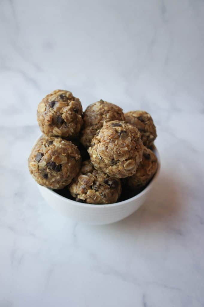 Tasty chocolate chip peanut butter coconut no bake energy bites are the snack of the year! Take one (or five!) on the go as you go about your day or relax with a cup of coffee and one of these yummy treats!