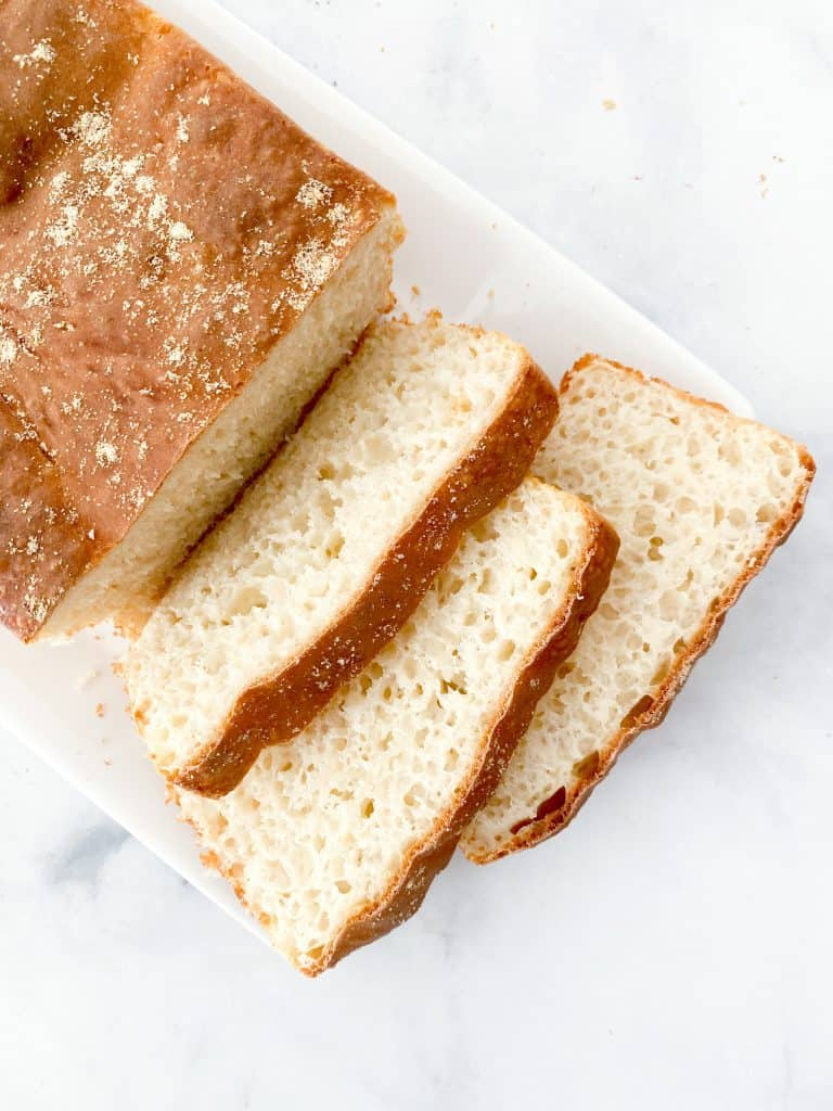 Slices of english muffin loaf with nooks and crannies on a plate