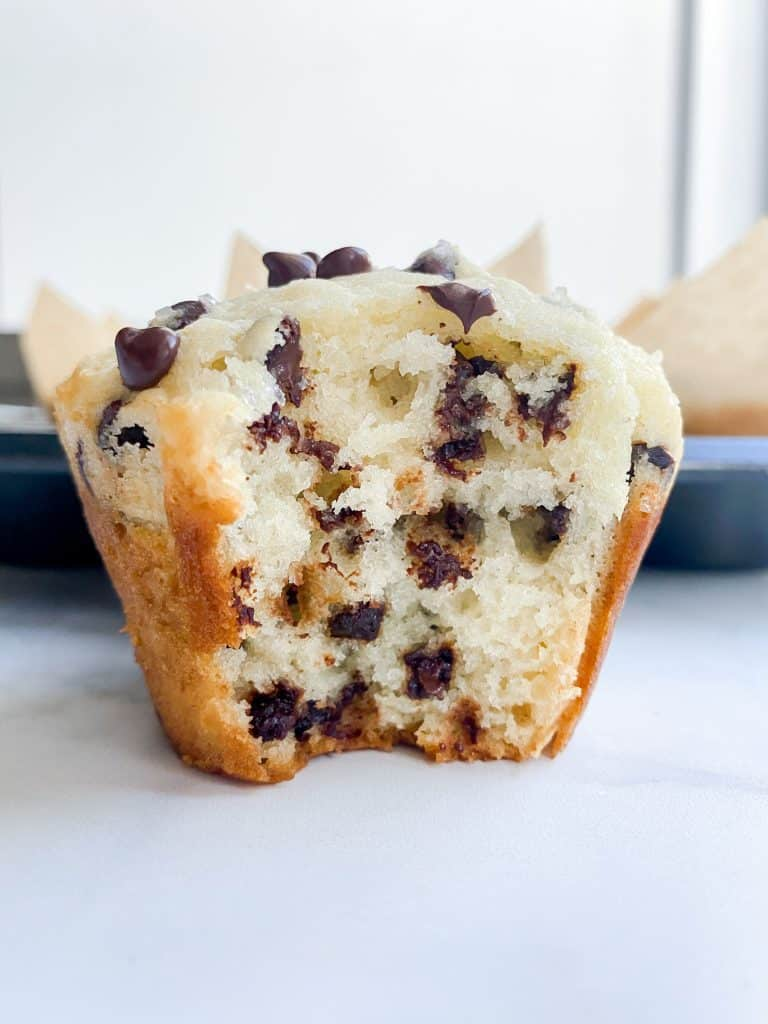 Bakery Style chocolate chip muffin with bite